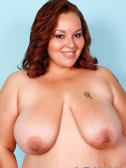 Red-haired fat chick in black lingerie disrobes and - Picture 3