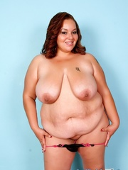 Red-haired fat chick in black lingerie disrobes and - Picture 4