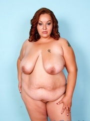Red-haired fat chick in black lingerie disrobes and - Picture 8
