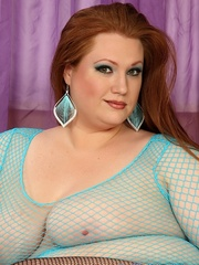 Jumbo brown-haired gal in cyan fishnet lingerie struts - Picture 11
