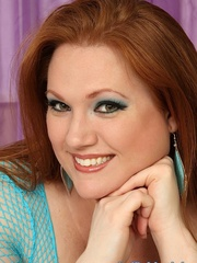 Jumbo brown-haired gal in cyan fishnet lingerie struts - Picture 13