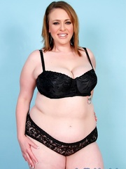 Chubby brown-haired dame in black lacy lingerie disrobes - Picture 1
