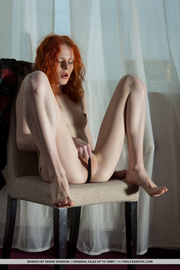 redhead black sweater and