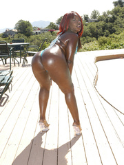 Kelly Reign is oiled for a fuck on a red sofa. - Picture 3
