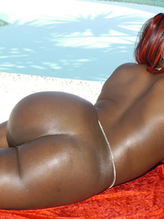 Kelly Reign is oiled for a fuck on a red sofa. - Picture 9