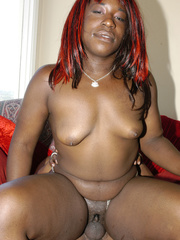 Kelly Reign is oiled for a fuck on a red sofa. - Picture 14