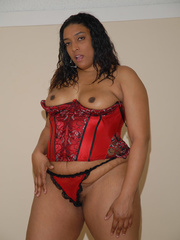 Cheyenne Foxx is in a red corset and panties and fucks - Picture 3