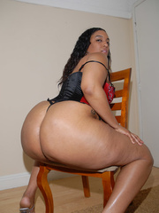 Cheyenne Foxx is in a red corset and panties and fucks - Picture 5