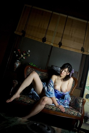 Young girl in a kimono does some glamour shots on the sofa. - XXXonXXX - Pic 8