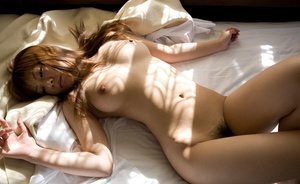 Chica in a sheer white dress and panties gets naked and touches herself in bed. - XXXonXXX - Pic 5