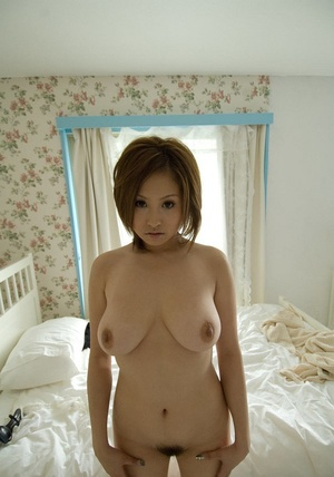 Busty dame in white underwear getting naked in the bedroom. - XXXonXXX - Pic 10