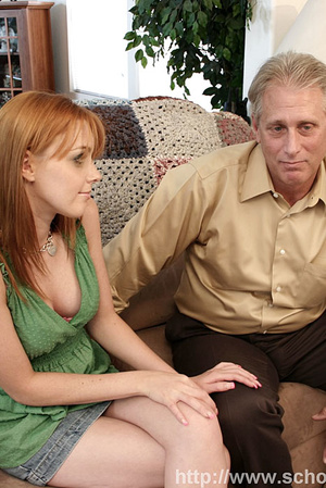 Redhead in a green dress and denim skirt does an old man on the couch. - XXXonXXX - Pic 3