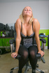 Young blondie on a chair pulls dress down exposing…