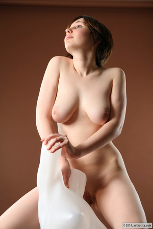 Beautiful slut in the nude poses with a white statue. - XXXonXXX - Pic 10