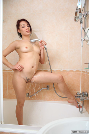 Desirable belle with a tattoo uses the shower head in the tub. - XXXonXXX - Pic 7