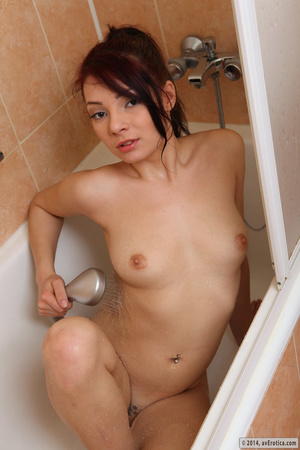 Desirable belle with a tattoo uses the shower head in the tub. - XXXonXXX - Pic 15