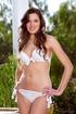Chica in white bikini and yellow heels unpins and…