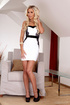 Blonde in white dress and black heels enjoys a sex…