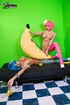 Naked chicks in pink and blue wigs and stockings grab big bananas and