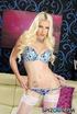 Tattooed slim blonde in blue underwear strips to…