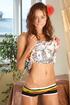 Slender brunette in a flower print dress and…