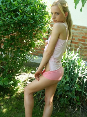 Cute slim teen blonde strip totally nude showing off sweet nude booty in garden - XXXonXXX - Pic 2