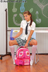 Ponytailed teen in a school uniform and long socks…