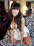 Wonderful brunette MILF beauty in a white lace baby-doll rubbing her slippery