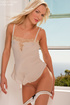 Blond in lace and ribbon lingerie goes stark naked…