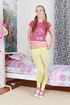 Lass in yellow tights and a pink shirt takes a…