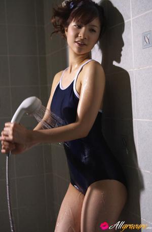 Bimbo gets wet in the bathroom in her blue swimsuit. - XXXonXXX - Pic 2