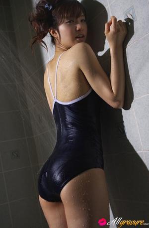 Bimbo gets wet in the bathroom in her blue swimsuit. - XXXonXXX - Pic 6