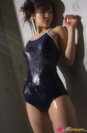 Bimbo gets wet in the bathroom in her blue swimsuit. - XXXonXXX - Pic 7
