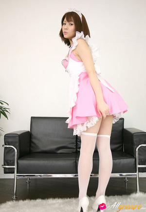 Harlot in a sexy pink maid's uniform poses on a black couch. - XXXonXXX - Pic 1