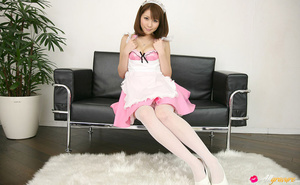 Harlot in a sexy pink maid's uniform poses on a black couch. - XXXonXXX - Pic 2