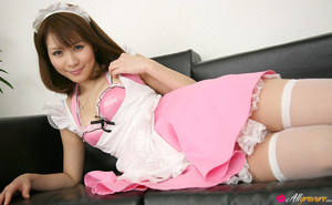 Harlot in a sexy pink maid's uniform poses on a black couch. - XXXonXXX - Pic 6