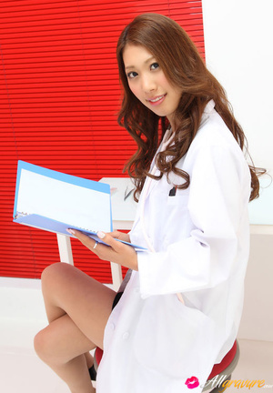 Dame in a white doctor's coat poses with her stethoscope. - XXXonXXX - Pic 2