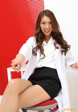 Dame in a white doctor's coat poses with her stethoscope. - XXXonXXX - Pic 10