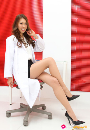 Dame in a white doctor's coat poses with her stethoscope. - XXXonXXX - Pic 11