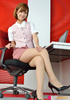 Girlie in a pink shirt and stockings poses at her…