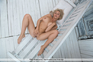 Platinum blonde in white panties gets naked and spreads on a bench. - XXXonXXX - Pic 10