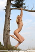 Buck naked blonde posing with a tree and on the…