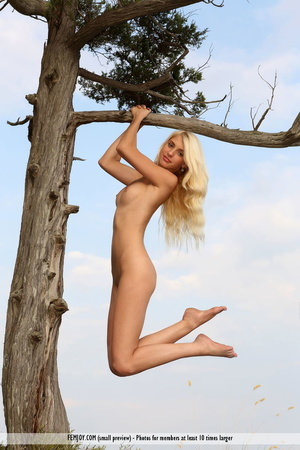 Buck naked blonde posing with a tree and on the rocks. - XXXonXXX - Pic 11