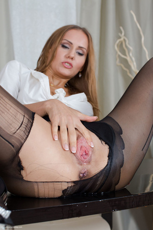 Fabulous toots rips her black pantyhose and pisses on a black table. - XXXonXXX - Pic 5