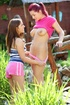 Lovely gals have sex toy lesbo sex in the garden.