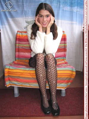 Playful brunette freshie in a white blouse teasing you with her slim legs in polka-dot tights - XXXonXXX - Pic 1