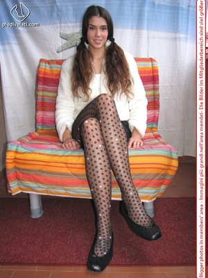 Playful brunette freshie in a white blouse teasing you with her slim legs in polka-dot tights - XXXonXXX - Pic 3