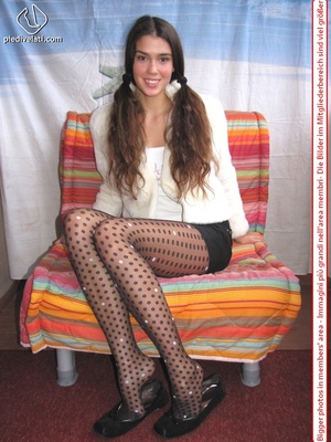 Playful brunette freshie in a white blouse teasing you with her slim legs in polka-dot tights - XXXonXXX - Pic 6