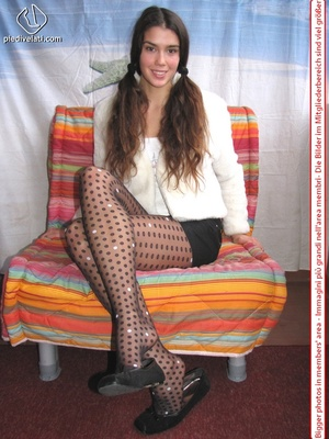 Playful brunette freshie in a white blouse teasing you with her slim legs in polka-dot tights - XXXonXXX - Pic 7