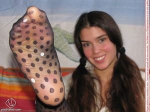 Playful brunette freshie in a white blouse teasing you with her slim legs in polka-dot tights - XXXonXXX - Pic 9